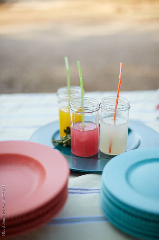 Colorful beverages on a children's party table by Miquel Llonch for Stocksy United