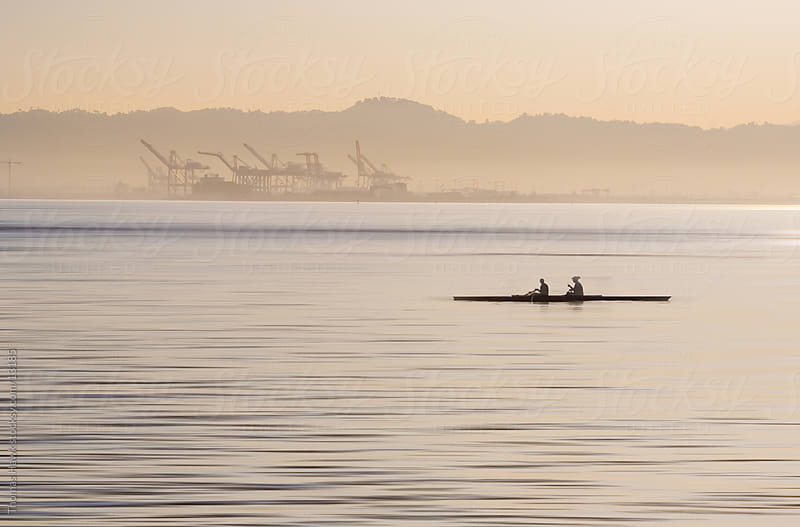 Two boaters rowing on the San Francisco Bay by Thomas Hawk for Stocksy United