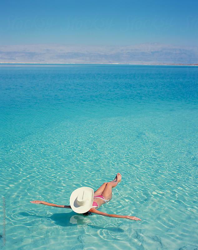 woman floating on the Dead Sea. Israel. by Hugh Sitton for Stocksy United