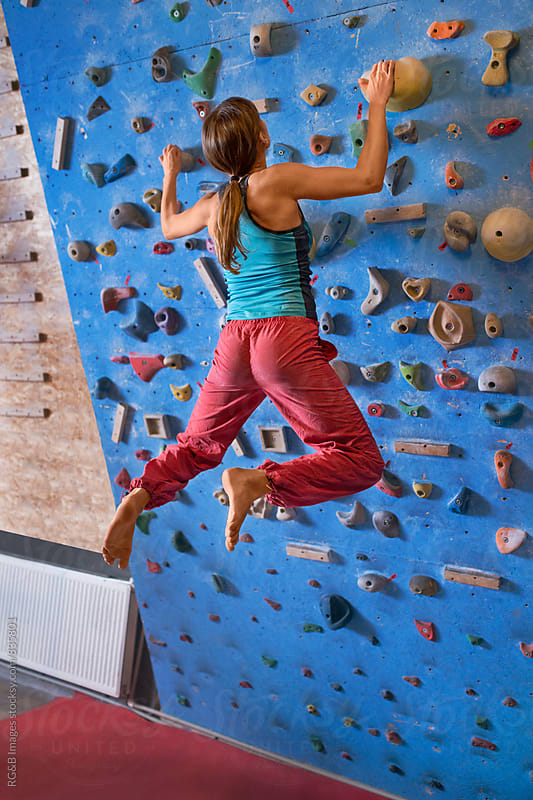Woman training for rock climbing indoor by RG&B Images for Stocksy United