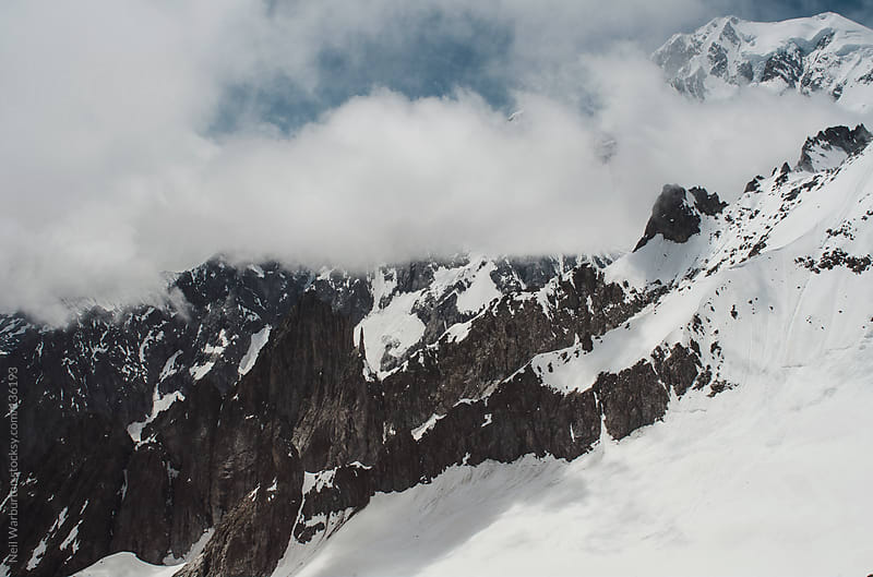 Mont Blanc in the Clouds by Neil Warburton for Stocksy United