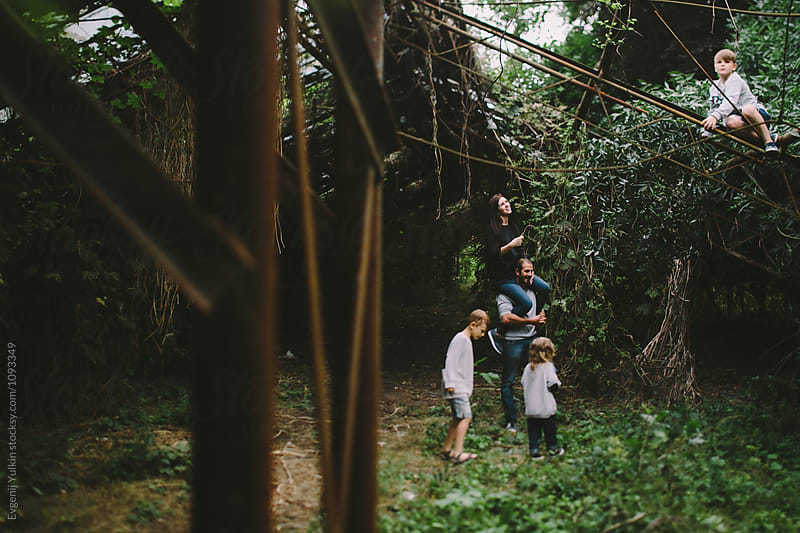 Family with three boys discovering  abandoned greenhouse   by Evgenij Yulkin for Stocksy United