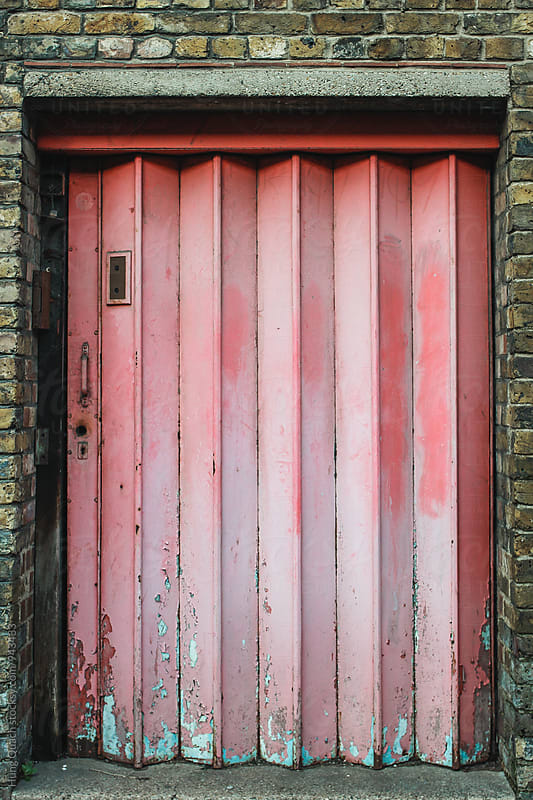Pink Corrugated Door by Hung Quach for Stocksy United