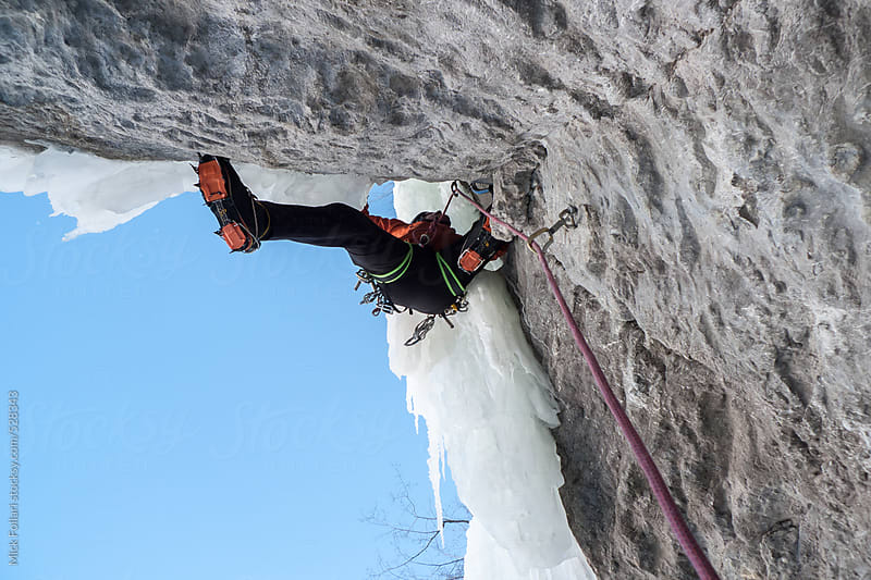 Climber on mixed ice and rock climb in crampons by Mick Follari for Stocksy United