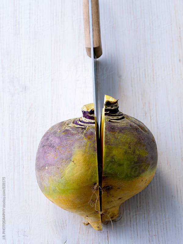 Raw swede with knife by J.R. PHOTOGRAPHY for Stocksy United