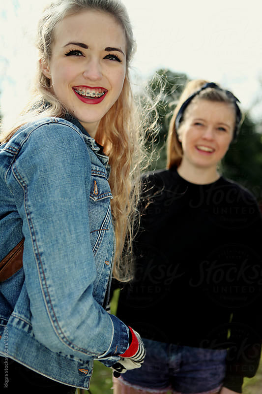 Two teenagers smiling. by kkgas for Stocksy United