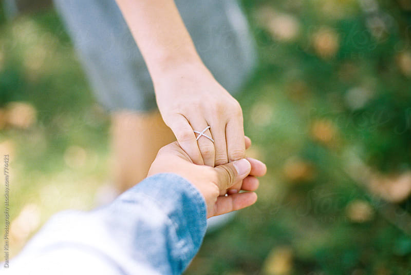 Close up of hand holding by Daniel Kim Photography for Stocksy United