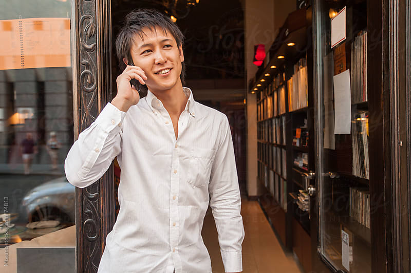 Man Talking on the Phone and Smiling by Mosuno for Stocksy United