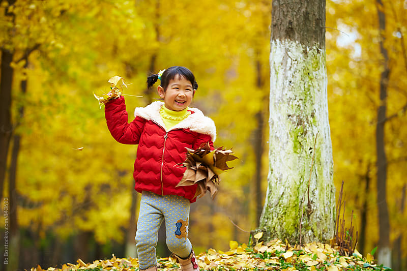 one little asian girl running outdoor in the woods by Bo Bo for Stocksy United