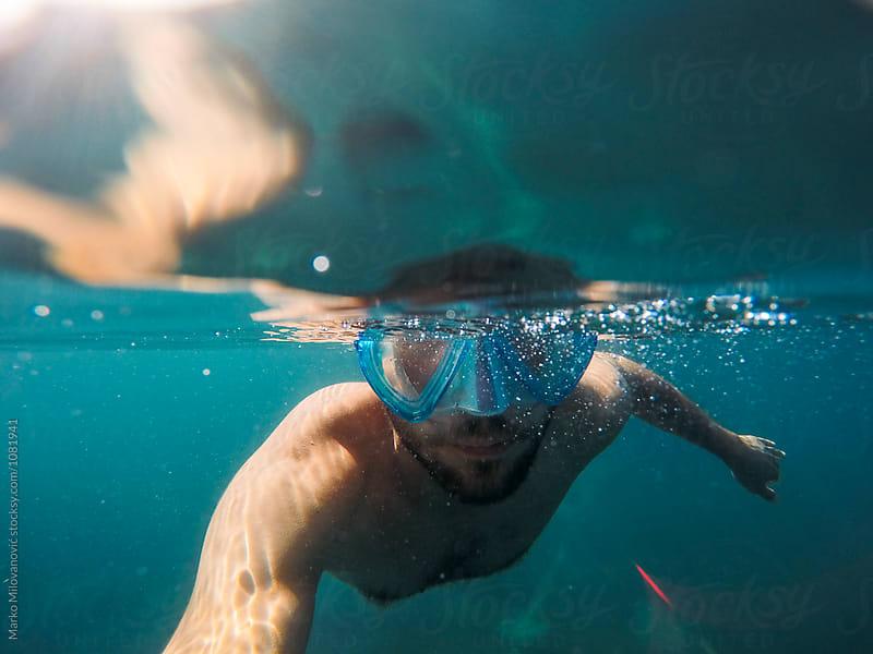 Underwater portrait of young man snorkeling by Marko Milovanović for Stocksy United