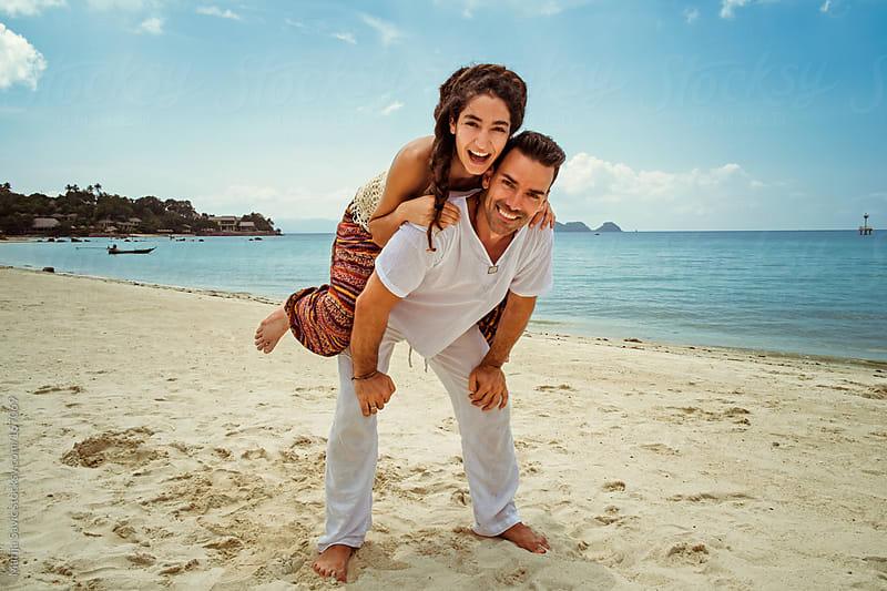 Happy Couple on the Beach by Marija Savic for Stocksy United