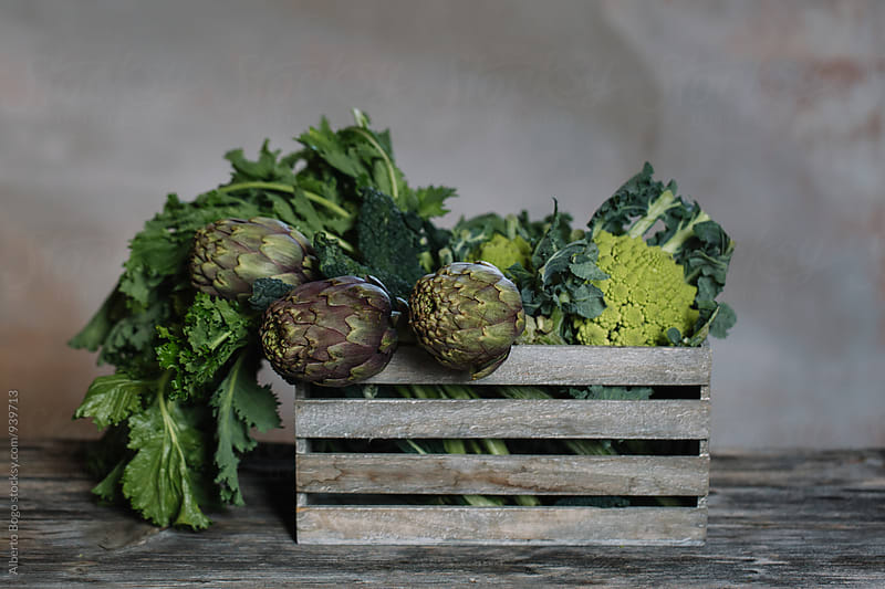 Box of artichoke, broccoli and cabbage by Alberto Bogo for Stocksy United