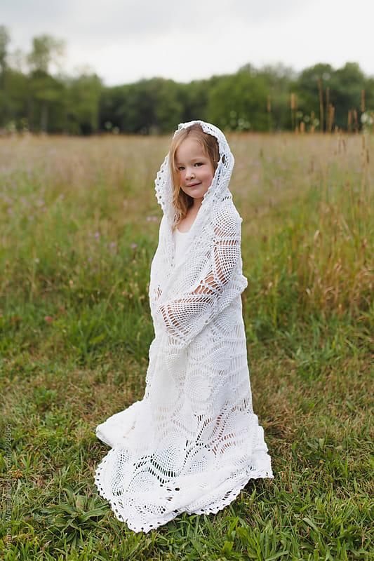 Beautiful young girl dressed up as a bride by Amanda Worrall for Stocksy United