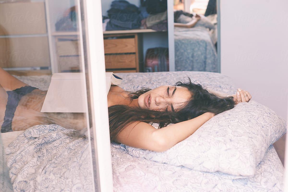 Nude girl sleeping in bed