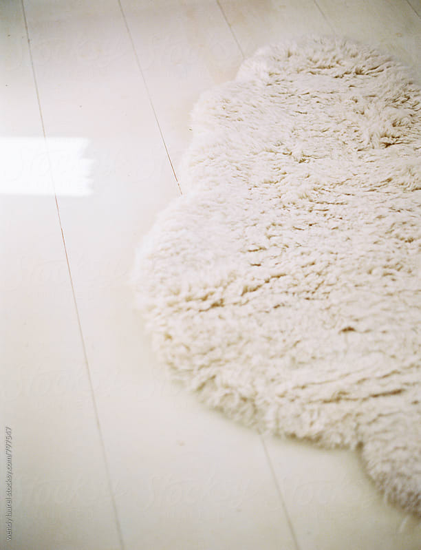 white shaggy cloud rug on white plank floor by wendy laurel for Stocksy United
