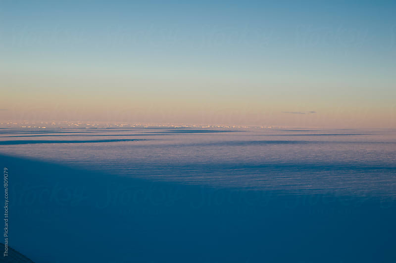 View of the polar plateau with icebergs and sea ice in the distance, Antarctica. by Thomas Pickard Photography Ltd. for Stocksy United