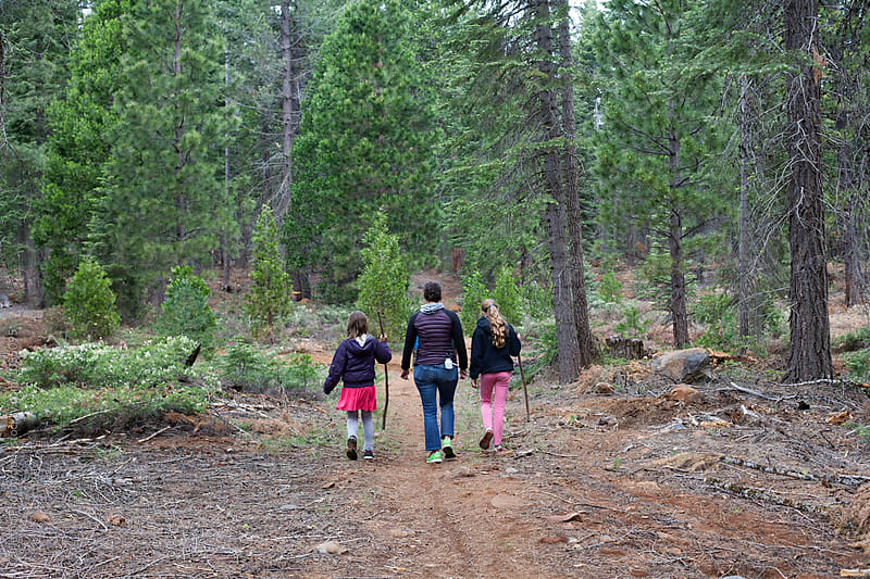 Mom and two daughters hiking on the Pacifc Crest Trail by Carleton Photography for Stocksy United