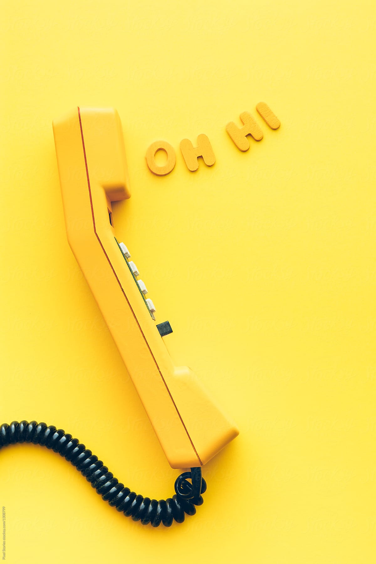 Old Yellow Phone With Greeting Coming Out From Earpiece Stocksy United