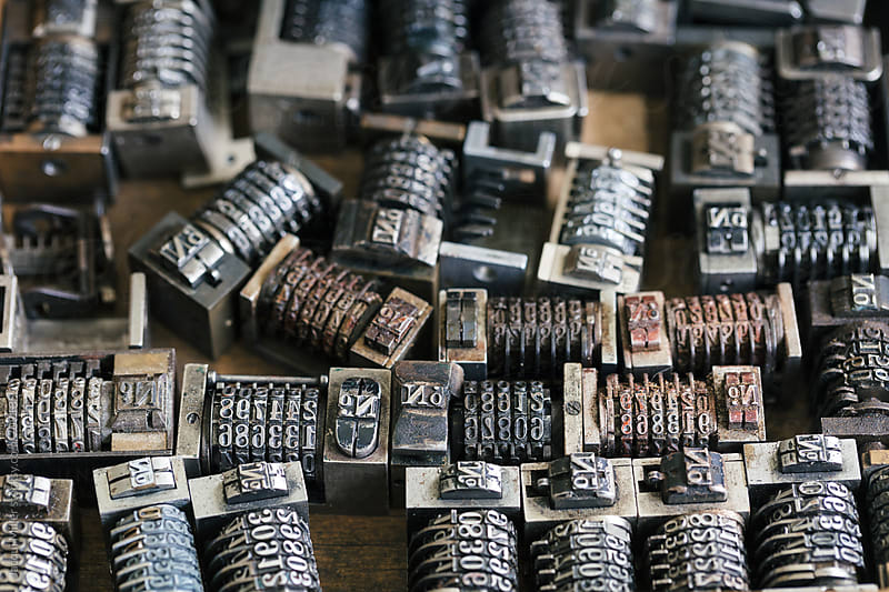 Close up of vintage metal numbering inserts for printer by Jacqui Miller for Stocksy United