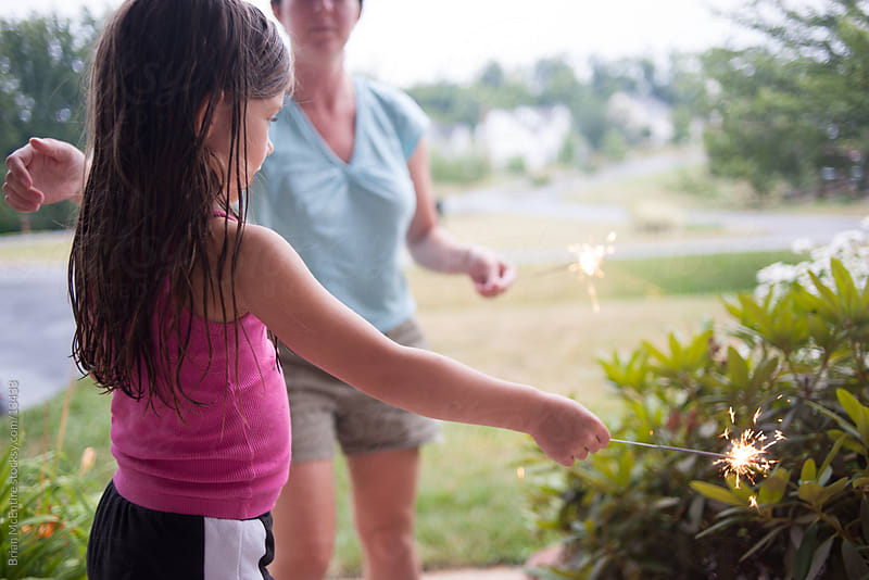 First Sparklers for Little Girl on July 4th by Brian McEntire for Stocksy United