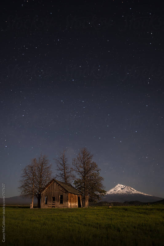 Mount Shasta and a Cabin by Casey McCallister for Stocksy United