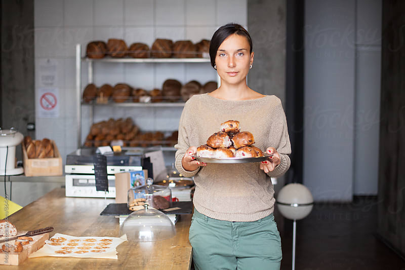 Baker Holding Fresh Pastry on a Plate by Mosuno for Stocksy United