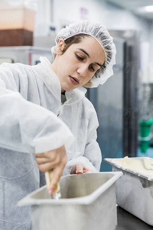 Woman with sterile clothing working in ice cream factory by Lior + Lone for Stocksy United