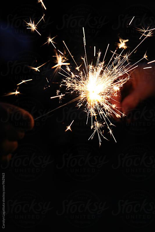 Sparkler in the dark by Carolyn Lagattuta for Stocksy United