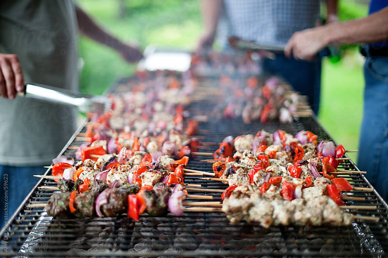 3 Men Grilling Kabobs by Amy Drucker for Stocksy United