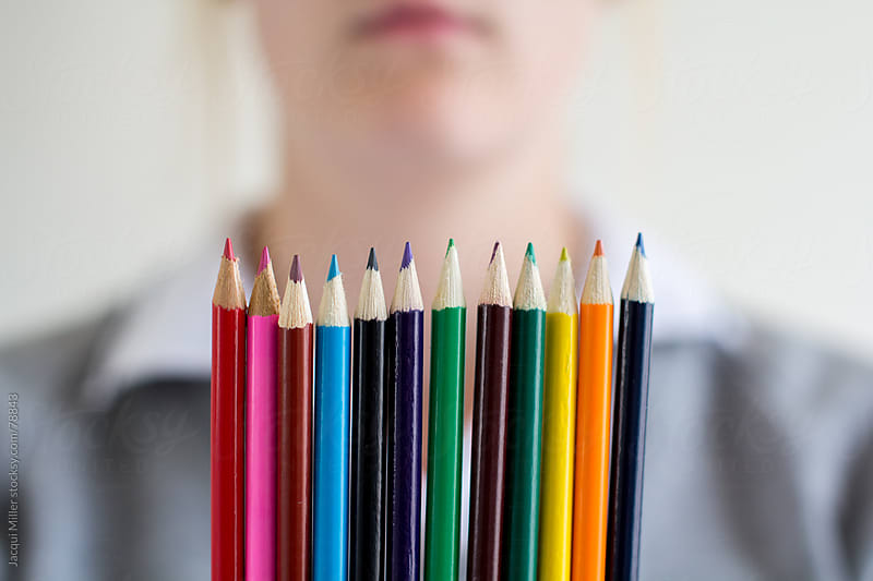 Girl with colourful pencils by Jacqui Miller for Stocksy United