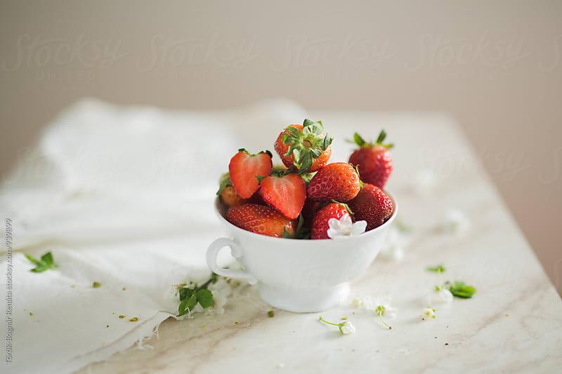 Still life of a cup of fresh strawberries by Török-Bognár Renáta for Stocksy United