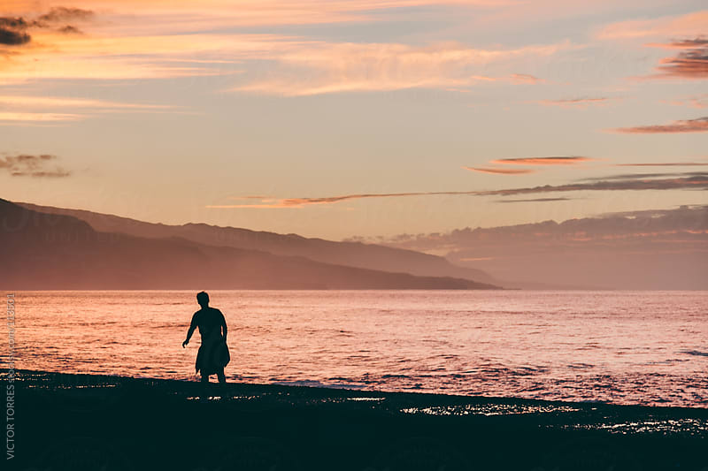 Man Walking Near Sea at Sunset by VICTOR TORRES for Stocksy United