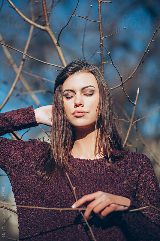 Beautiful young fashionable woman outdoors by Maja Topcagic for Stocksy United
