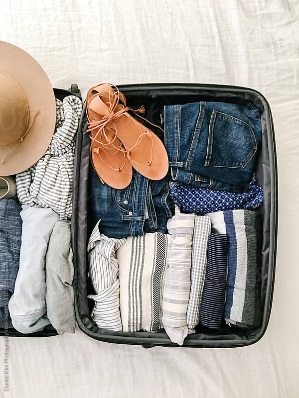 Suitcase with packed clothes and accessories