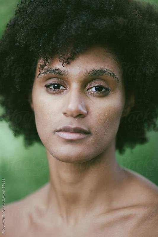 Black woman by Robert Kohlhuber for Stocksy United