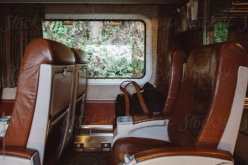 Luggage on train seat by Carey Shaw for Stocksy United