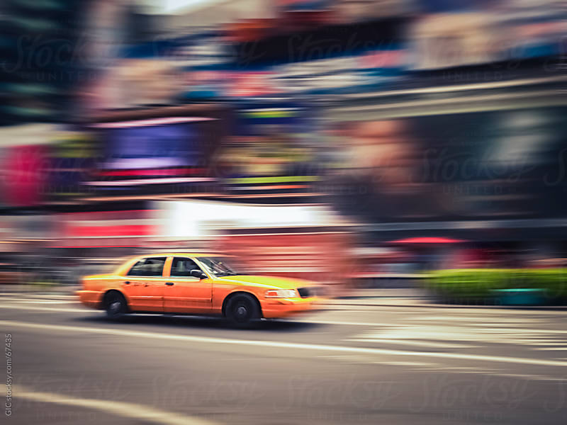Taxi running in New York City by Simone Becchetti for Stocksy United