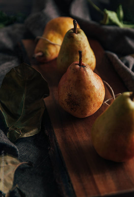 Pears on a wooden cutboard by Nataša Mandić for Stocksy United