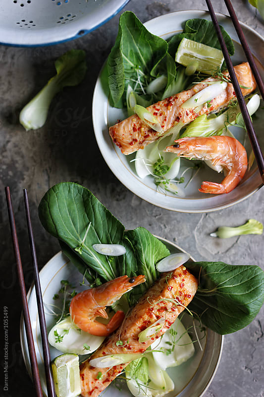 Chili lime salmon with pak choi. by Darren Muir for Stocksy United