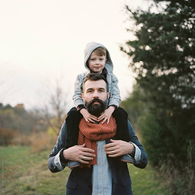 Cute son sitting on the shoulder of his handsome father by Jakob for Stocksy United