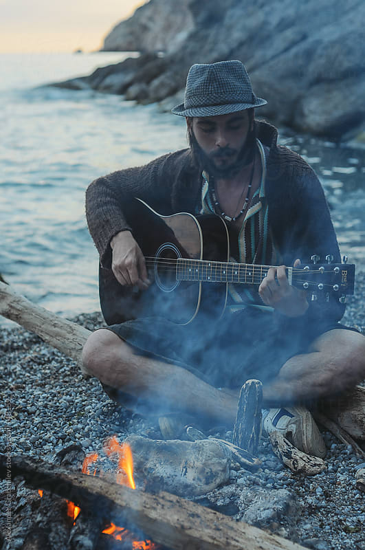 Man Playing Guitar on the Beach by Alexander Grabchilev for Stocksy United