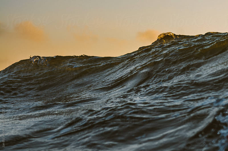 wave breaking at sunset in domburg  by Jan Bijl for Stocksy United