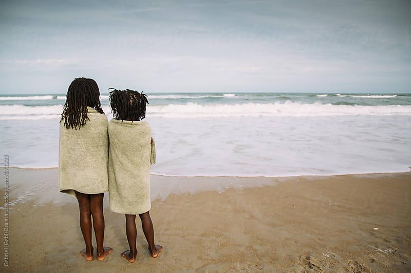 Two black girls in towels by the beach by Gabriel (Gabi) Bucataru for Stocksy United