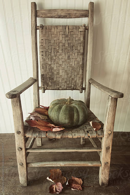 Old wooden chair with green pumpkin by Sandra Cunningham for Stocksy United