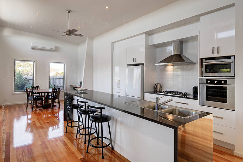 Contemporary Kitchen and Dinin space by Rowena Naylor for Stocksy United