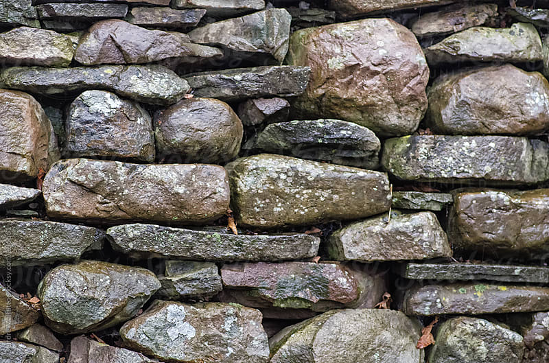 dry-stone stone wall background by Deirdre Malfatto for Stocksy United