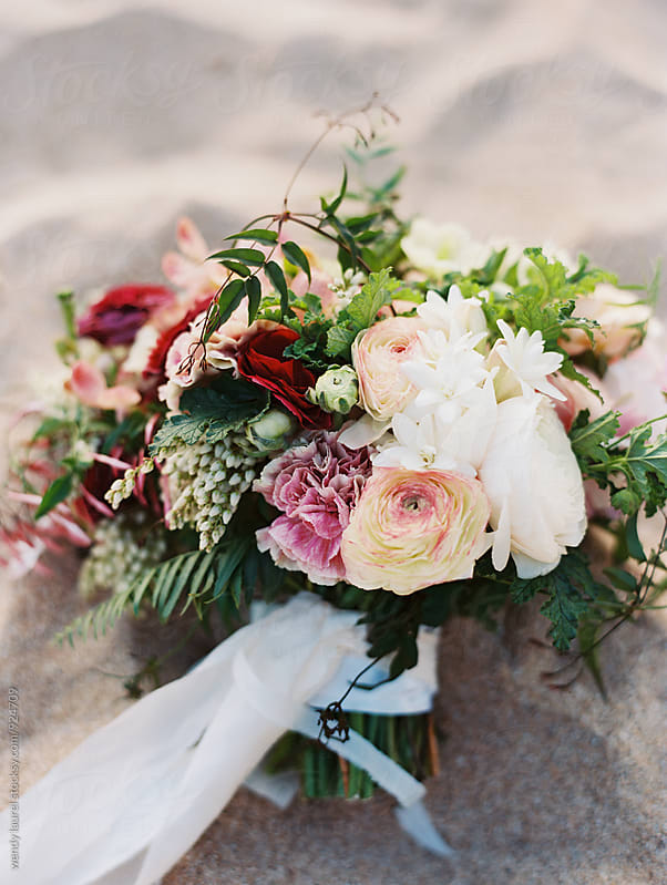 gorgeous luxury floral wedding bouquet with red and peach by wendy laurel for Stocksy United