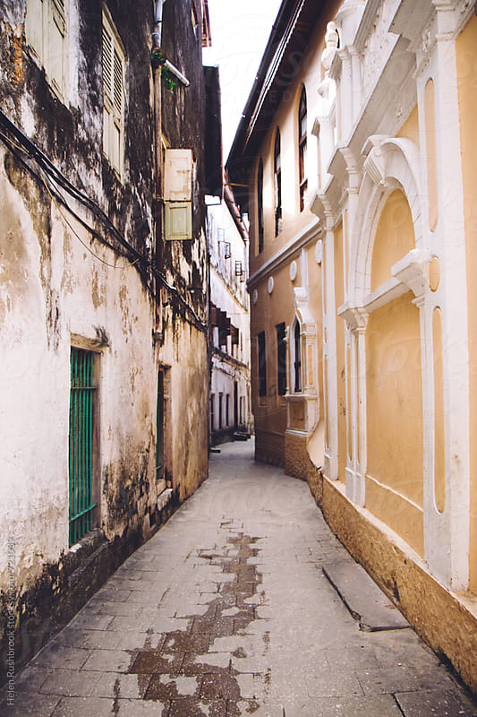 The narrow streets of Stone Town, Zanzibar. by Helen Rushbrook for Stocksy United
