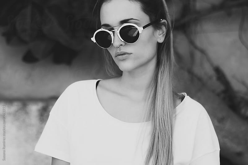 Portrait of woman wearing sunglasses by Susana Ramírez for Stocksy United