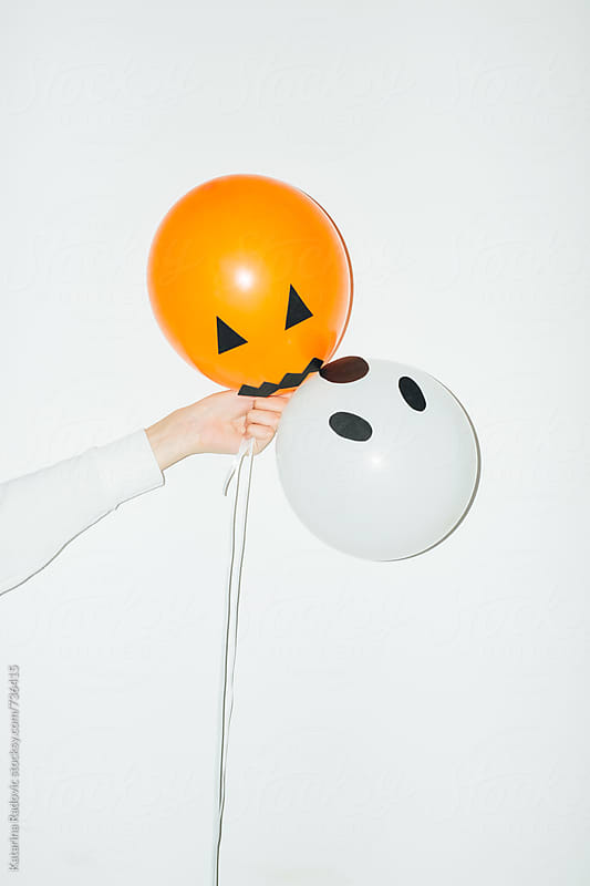 Woman Holding Halloween Party Balloons by Katarina Radovic for Stocksy United